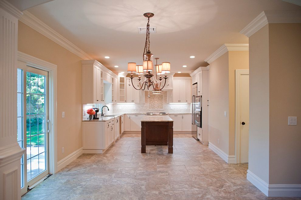 Fuda Tile for a Traditional Kitchen with a Ivory Cabinets and Woodland Estate by Elayan Construction Services