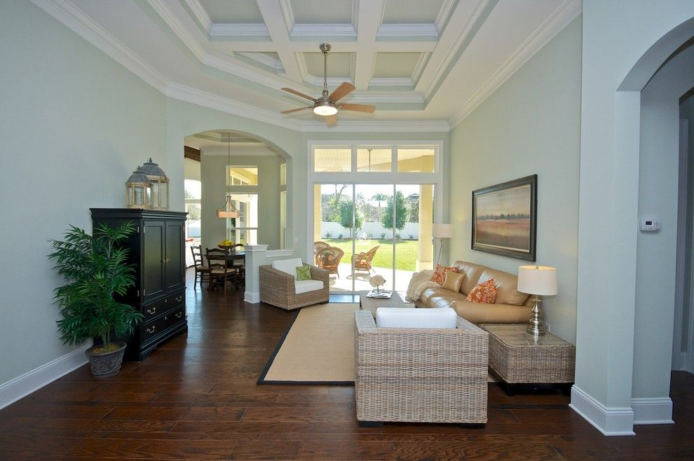Furniture Mart Jacksonville Fl for a Traditional Living Room with a Arched Doors and Andy Reynolds Homes Hunters Creek Model by Staging & ReDesign
