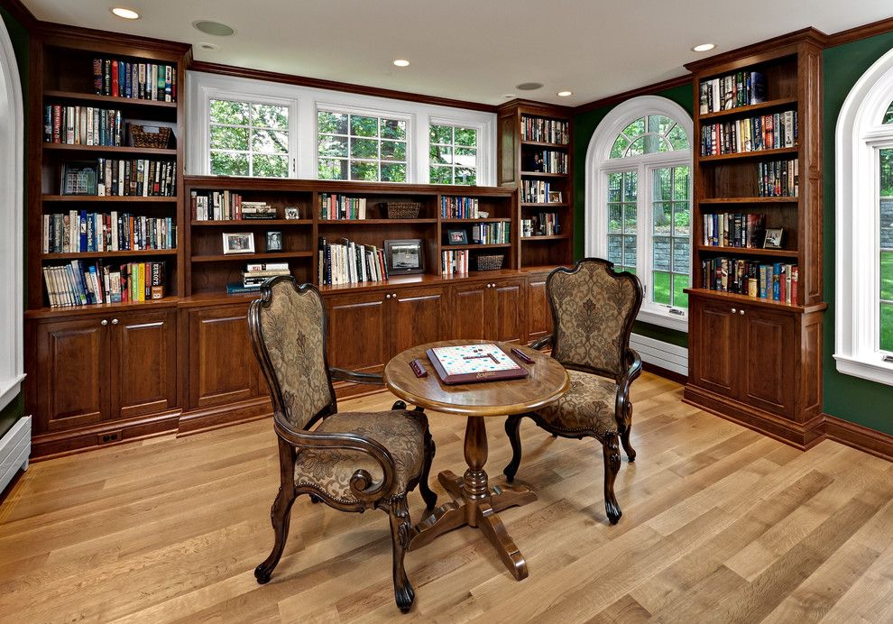 Gabberts Furniture for a Traditional Family Room with a Library and Gummy Cherry Library by Steven Cabinets