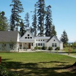 Gable Roof for a Transitional Exterior with a Cupola and View From Road. by Dan Nelson, Designs Northwest Architects