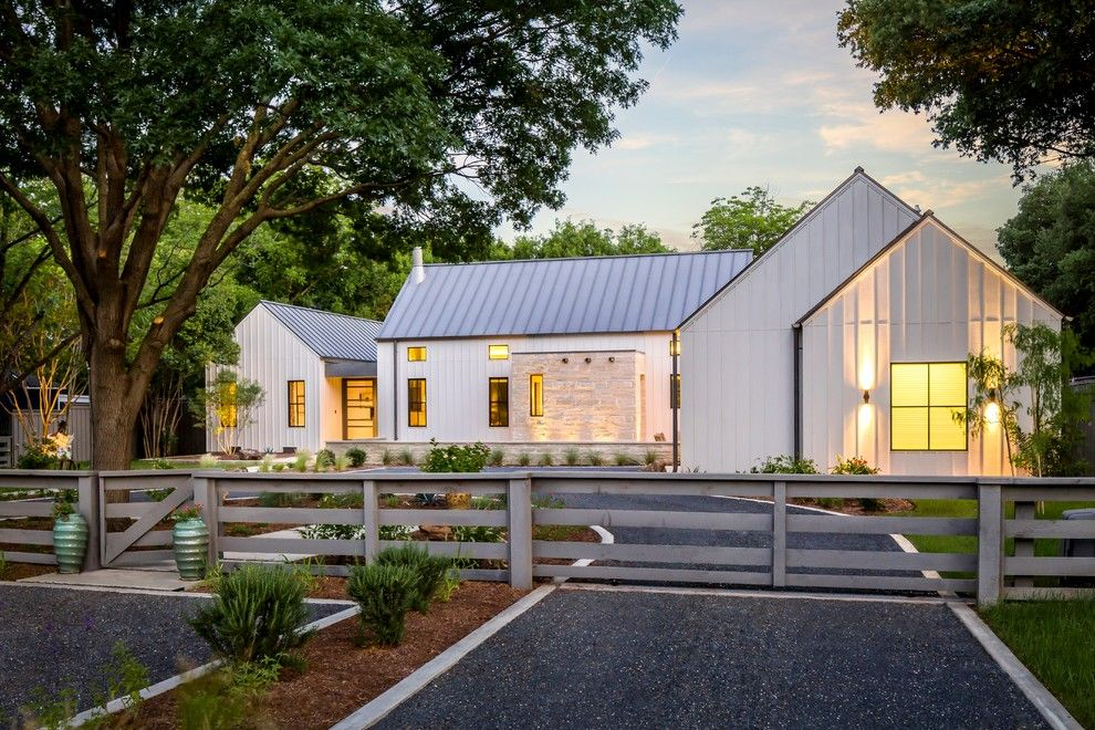 Gabled Roof for a Farmhouse Exterior with a Gravel Driveway and Modern Farmhouse in Dallas, Texas by Olsen Studios