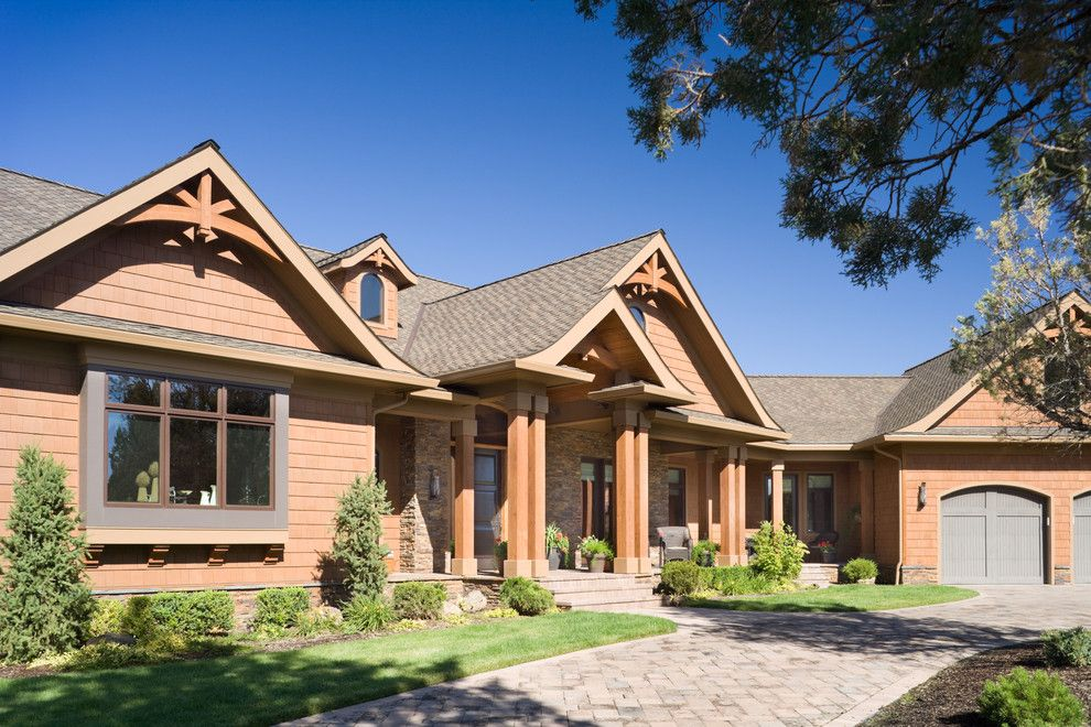 Gabled Roof for a Rustic Exterior with a Lawn and True Residence by Alan Mascord Design Associates Inc