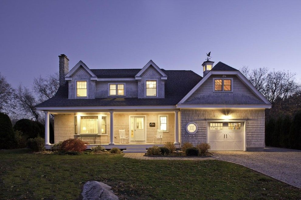 Gabled Roof for a Traditional Exterior with a Carriage Doors and Front Exterior at Dusk by Architecture | Interiors | Planning