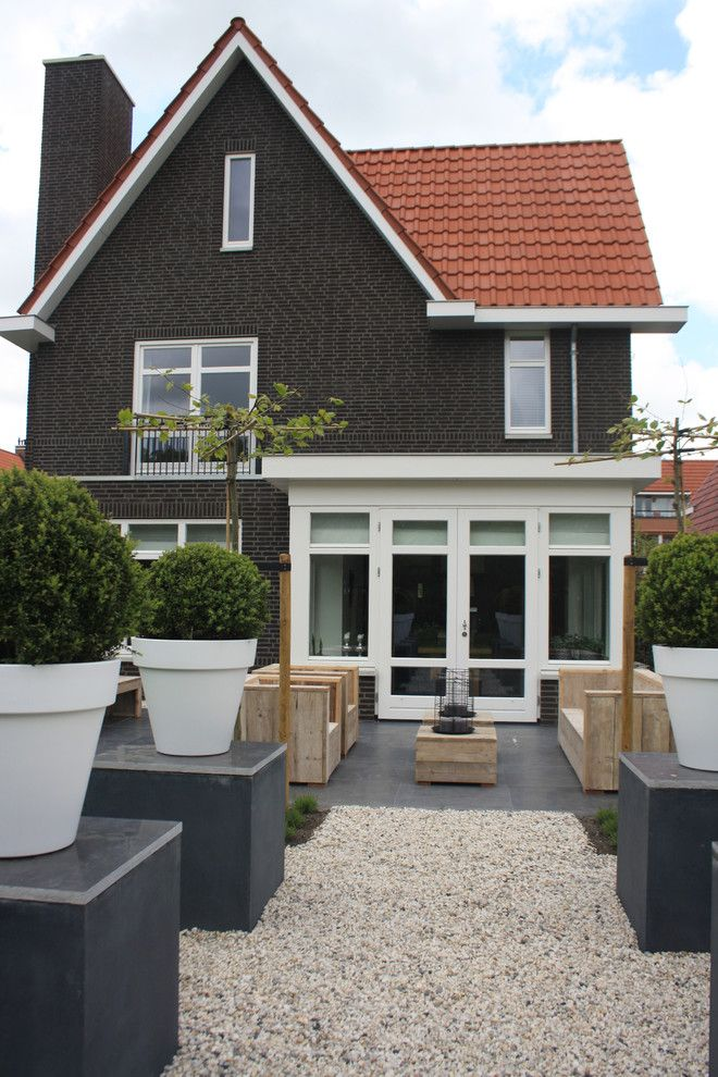 Gabled Roof for a Traditional Exterior with a Dark Brick and the Home of Wendy by Holly Marder