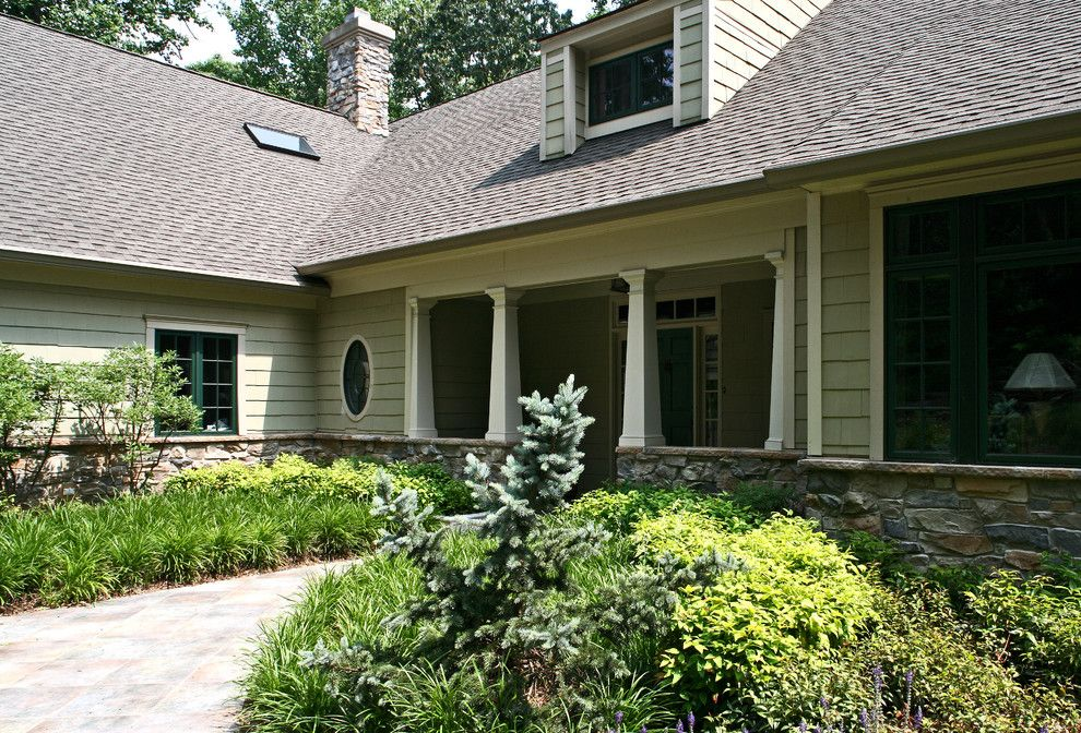 Gaf Shingles for a Craftsman Exterior with a Stone Facade and Hill Farm by Penza Bailey Architects