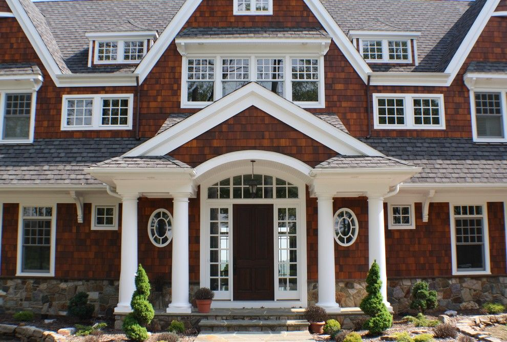 Gaf Shingles for a Victorian Exterior with a French Window and Street, Md by Custom Home Group