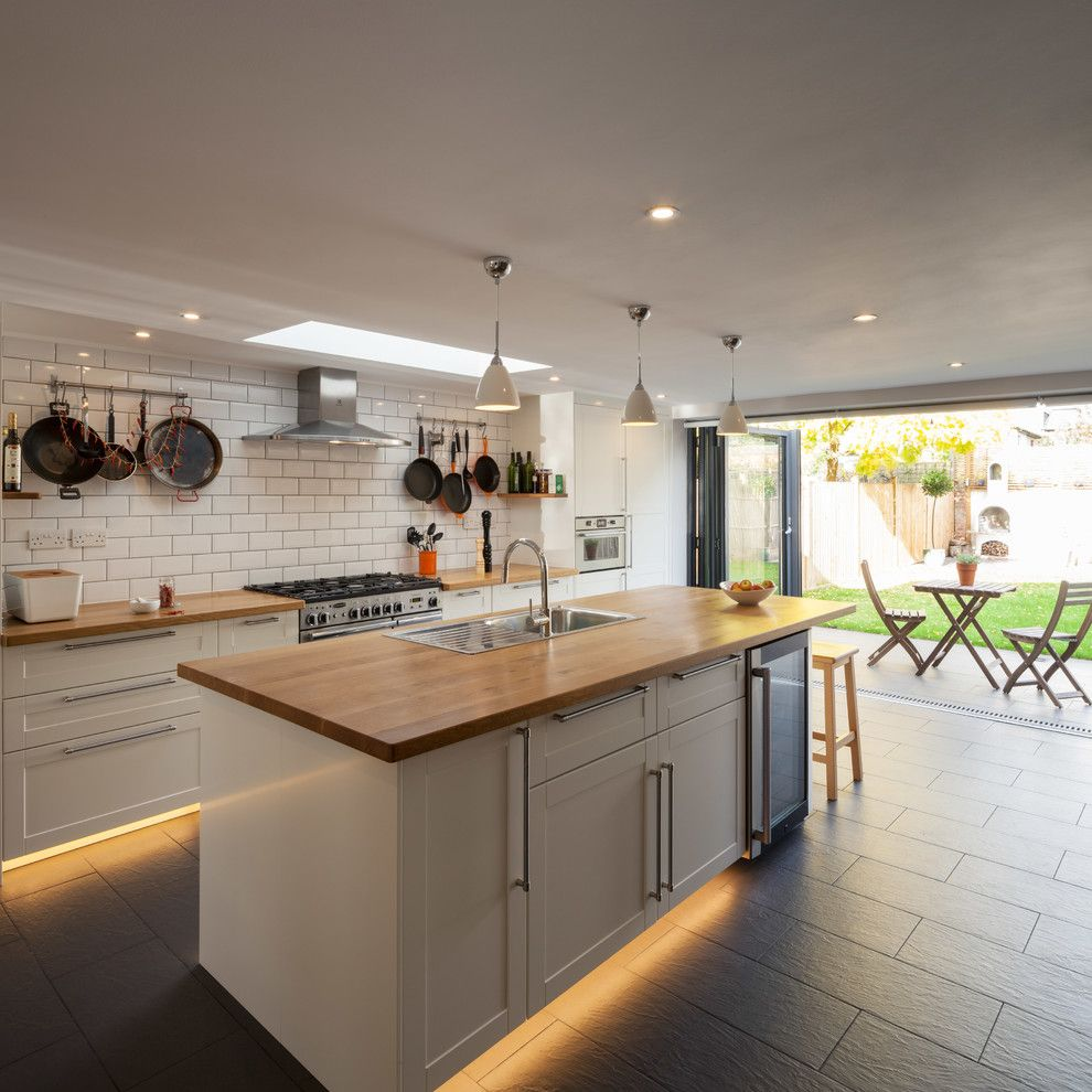 Galley Kitchen for a Transitional Kitchen with a Pan Rails and Cleaveland Road by Dblo Associates Architects