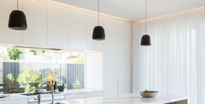 Galley Kitchen Ideas for a Scandinavian Kitchen with a Black Pendant Lights and LENNOX STREET HOUSE by Corben Architects