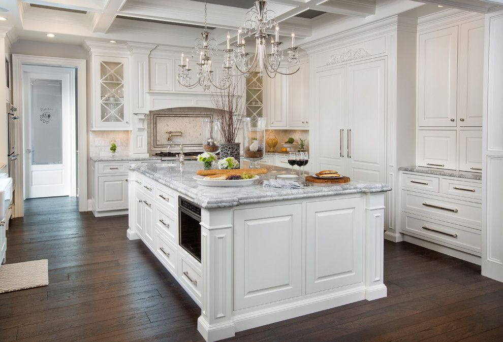 Galley Kitchen Ideas for a Traditional Kitchen with a Stainless Steel Appliances and Traditional White Kitchen with Hallmark Floors by Kichen Kraft Inc by Hallmark Floors