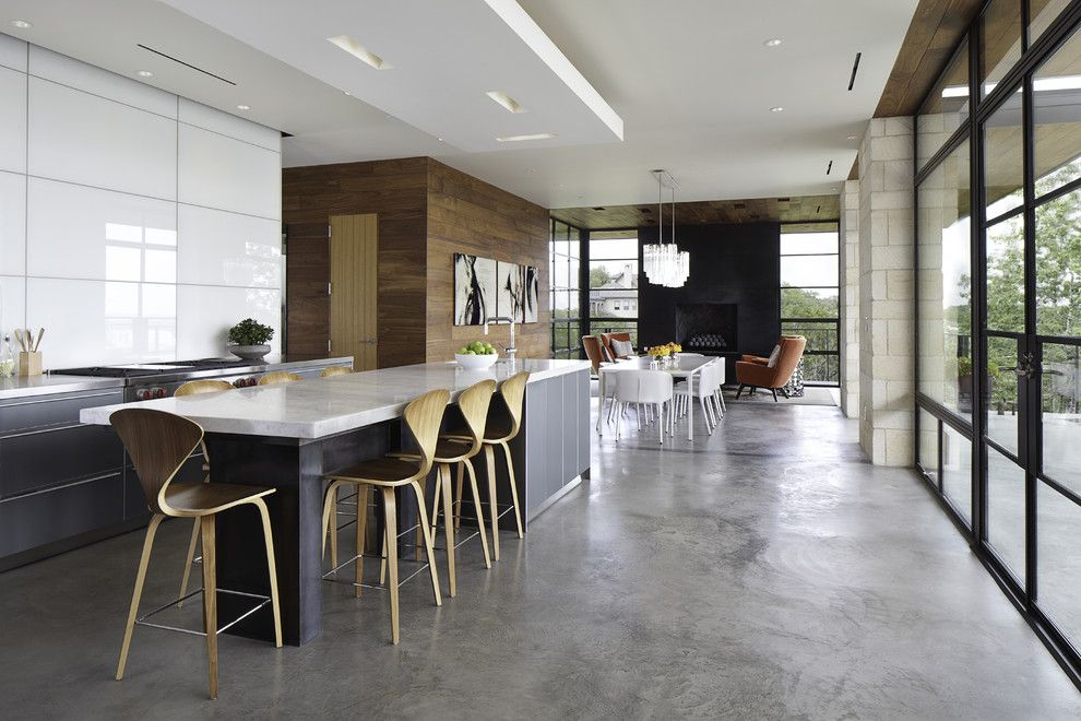 Galley Kitchens for a Modern Kitchen with a Black Fireplace and Hill Country Residence by Cornerstone Architects