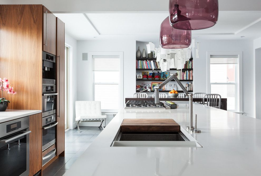 Galley Sink for a Contemporary Kitchen with a Floating Shelves and Modern Home in the Middle of St. John's by Becki Peckham