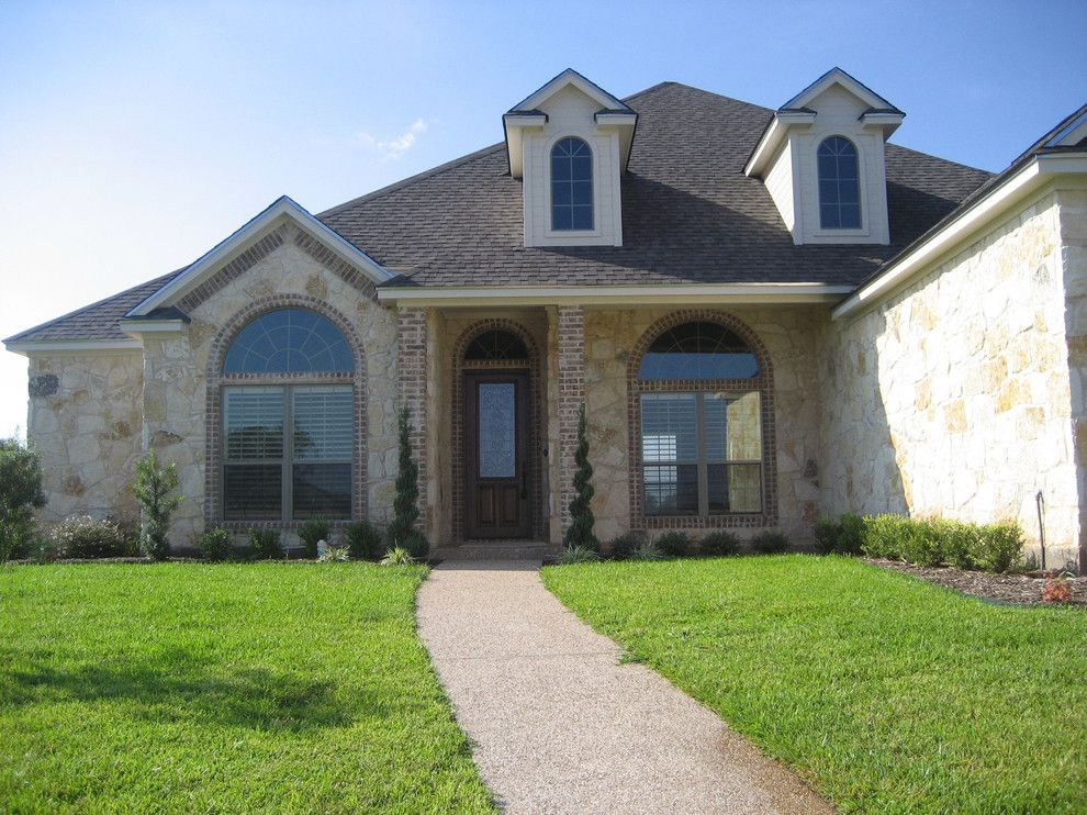 Garbett Homes for a  Spaces with a Custom Made and Exteriors by Kent Garbett Builder