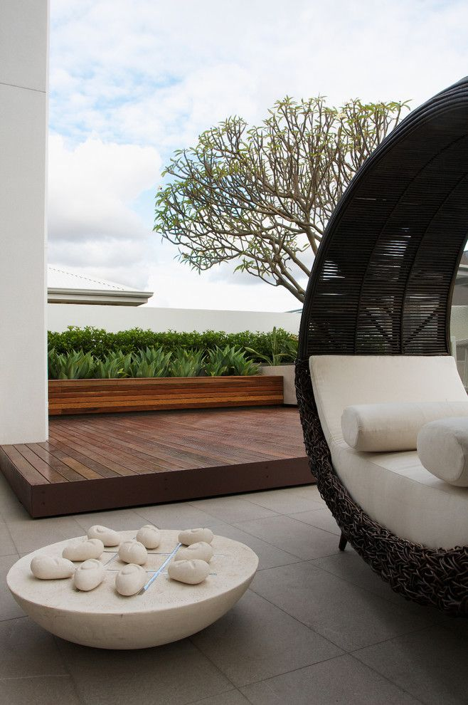 Garden Crossings for a Contemporary Patio with a Beige Outdoor Cushion and Harrisdale by Tim Davies Landscaping
