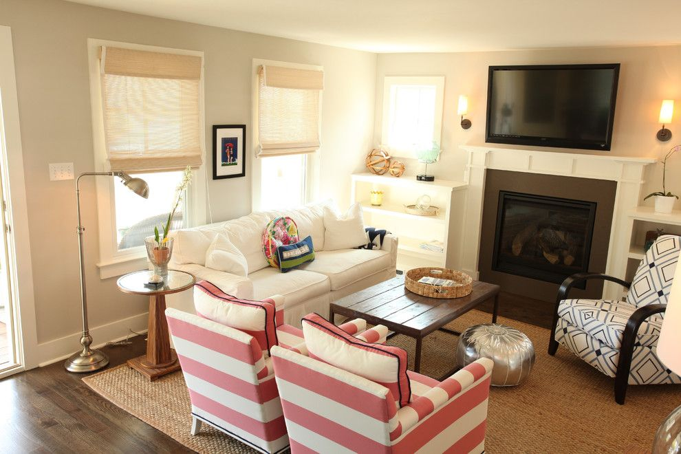 Gardner White Clearance for a Beach Style Living Room with a Fireplace and Beach Cottage Renovation by Kelley Gardner