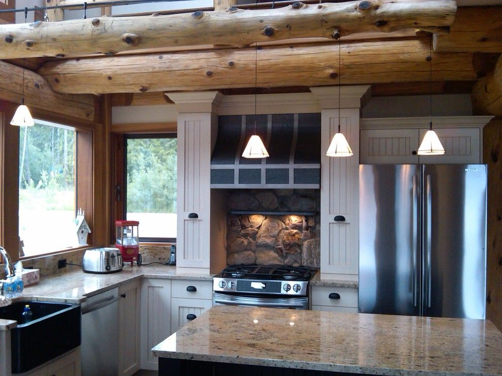 Gastineau Log Homes for a Rustic Kitchen with a Pendant Lights and Kitchen Ideas for Log Homes by Traditional Log Homes Ltd