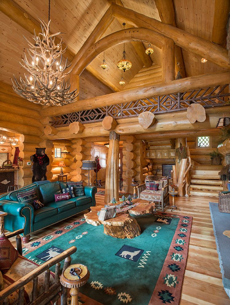 Gastineau Log Homes for a Rustic Living Room with a Chandelier and Big Moose, New York Log Home by Sitka Log Homes