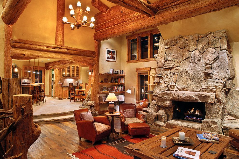 Gastineau Log Homes for a Traditional Living Room with a Stone Fireplace and Hybrid Log House by Sitka Log Homes