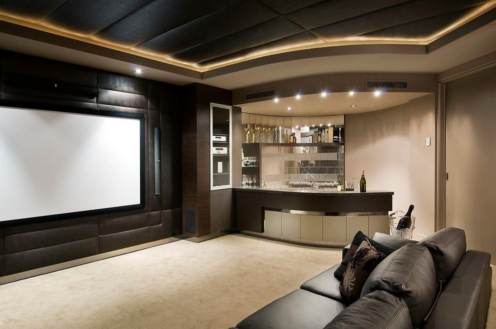 Gehan Homes for a Transitional Home Theater with a Mirrored Backsplash and the Resort by Zorzi