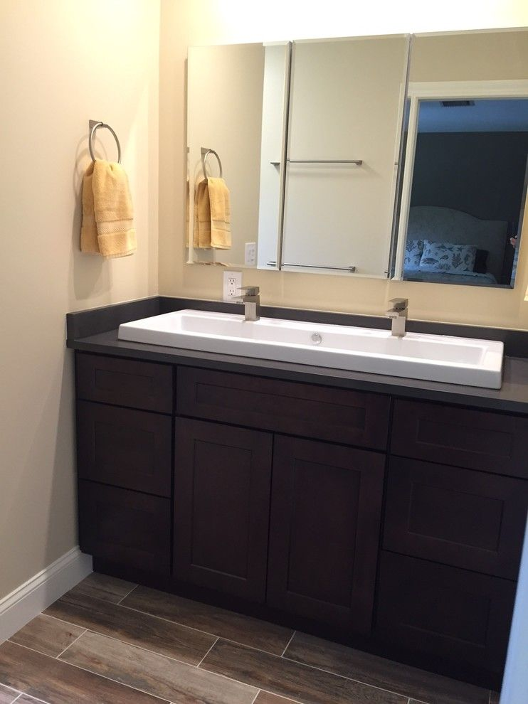 Gemco for a Contemporary Spaces with a Double Vessel Sink and Persson Bathroom Renovation by Gemco Usa