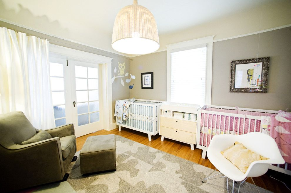 Gender Neutral Nursery for a Eclectic Nursery with a Wood Floor and Modern Nursery by Regan Baker Design