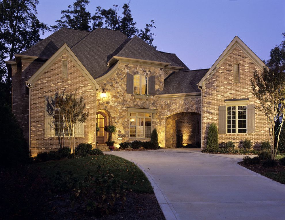 General Shale Brick for a Traditional Exterior with a Driveway and Ext by Grainda Builders, Inc.