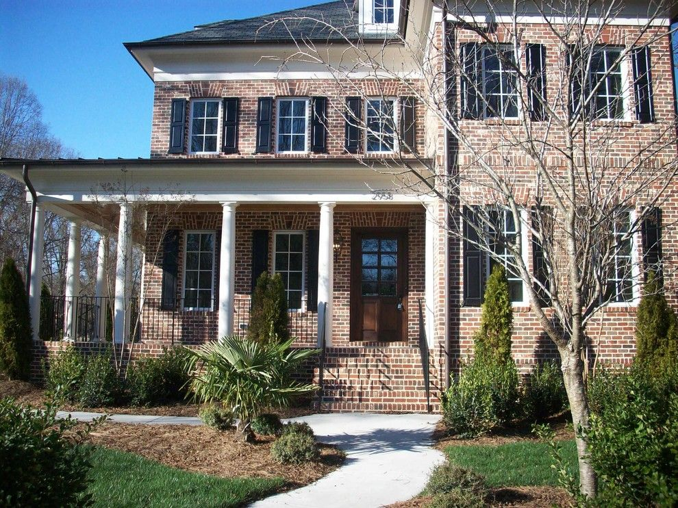 General Shale Brick for a Traditional Exterior with a Stone Facade and Exterior by Hickman Construction Company, Inc.