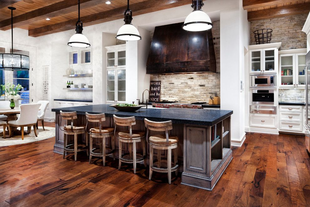 General Shale Brick for a Traditional Kitchen with a Large Vent Hood and Lake Austin by Luis Jauregui