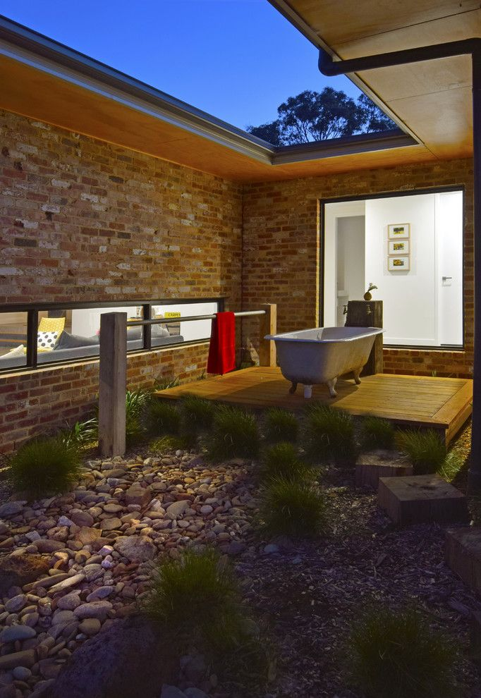 George Morlan Plumbing for a Contemporary Deck with a Bush Landscape and Batesford Homestead by Howden Homes