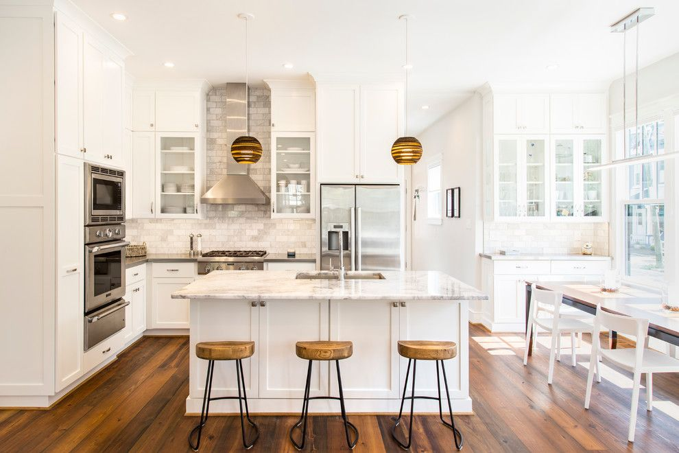 George Washington Toma for a Transitional Kitchen with a Wood Bar Stools and Leed Gold Home Renovation by R Michael Cross Design Group