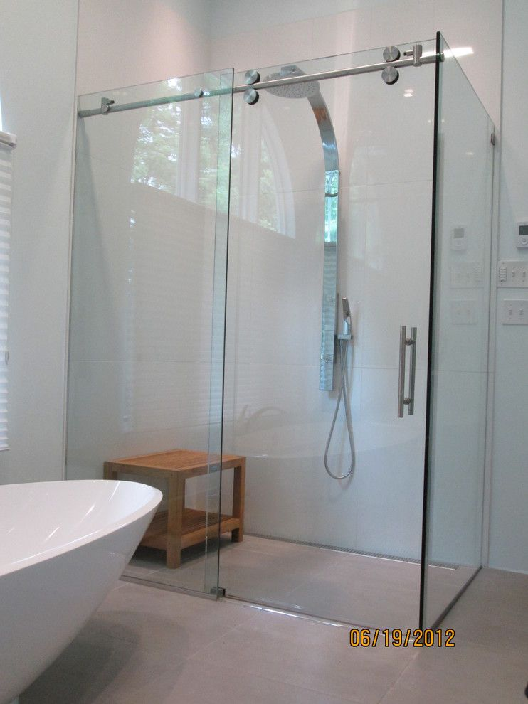Glass Crafters for a Contemporary Bathroom with a Contemporary Bathroom and Glasscrafters' Matrix Series by Glasscrafters Inc