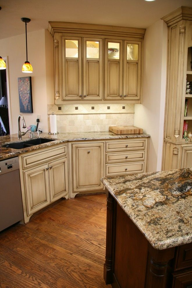 Glazing Cabinets for a Traditional Kitchen with a Glass Uppers and Brushy Creek Kitchen by Hatfield Builders & Remodelers