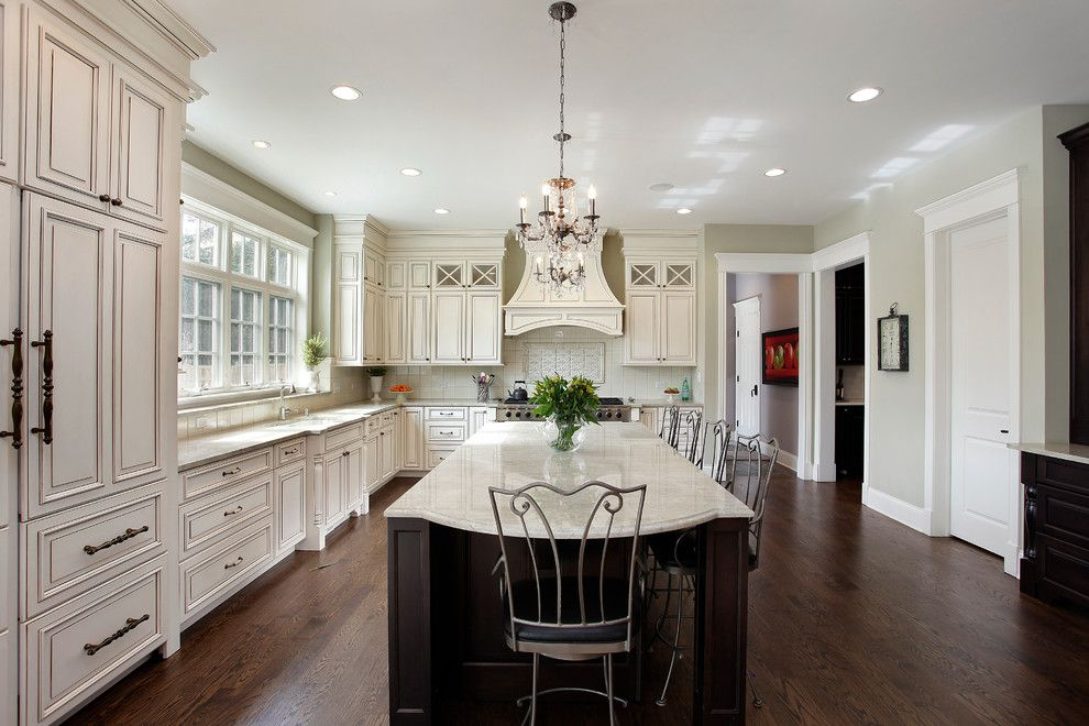 Glazing Cabinets for a Traditional Kitchen with a Metal Barstools and Design/build Winnetka by Sterling Wilson Design