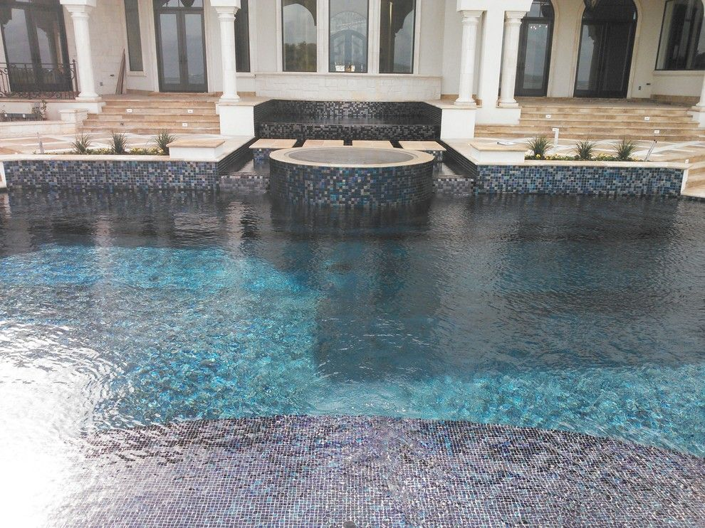 Gold Medal Pools for a Contemporary Pool with a Beach Step and Large All Tile Pool by Ocean Quest Pools by Lew Akins
