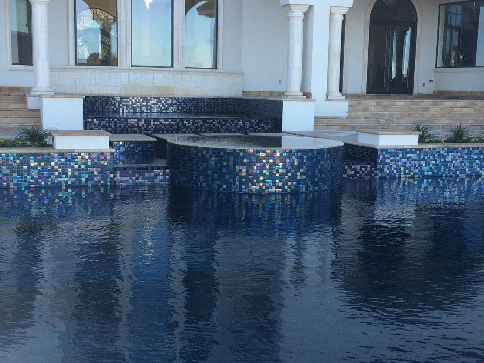 Gold Medal Pools for a Contemporary Pool with a Glass Tile and Large All Tile Pool by Ocean Quest Pools by Lew Akins
