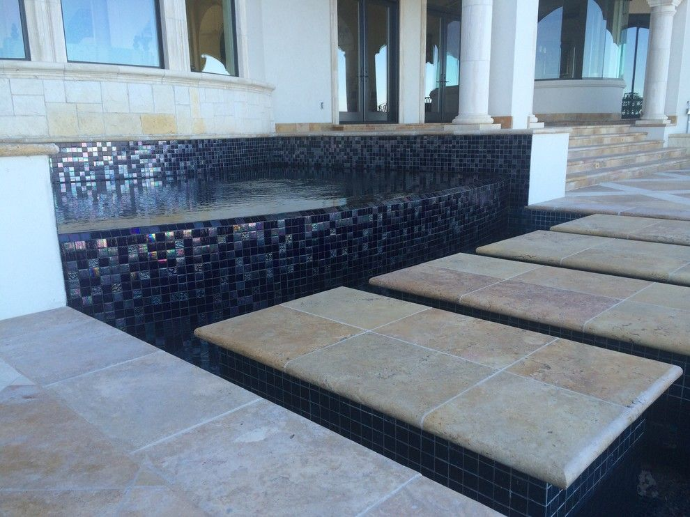 Gold Medal Pools for a Contemporary Pool with a Sun Shelf and Large All Tile Pool by Ocean Quest Pools by Lew Akins