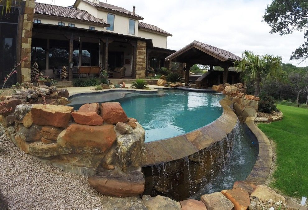 Gold Medal Pools for a  Pool with a Infinity and Vanishing Edge Pool with Swim Up Bar by Ocean Quest Pools by Lew Akins