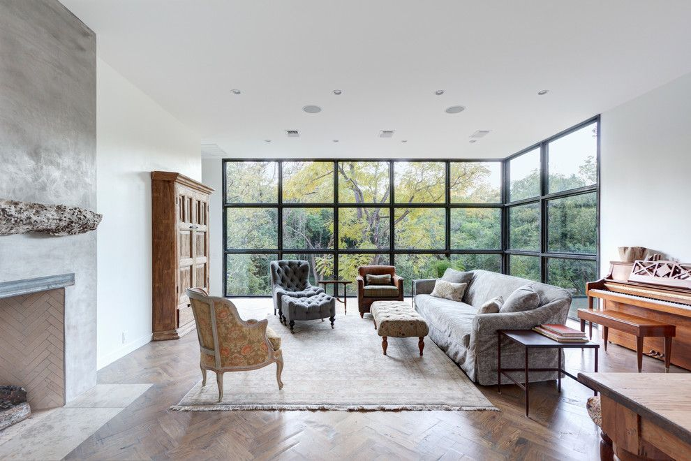 Gonzalez Furniture for a Contemporary Living Room with a Wall of Windows and Bouldin Creek Residence by Restructure Studio
