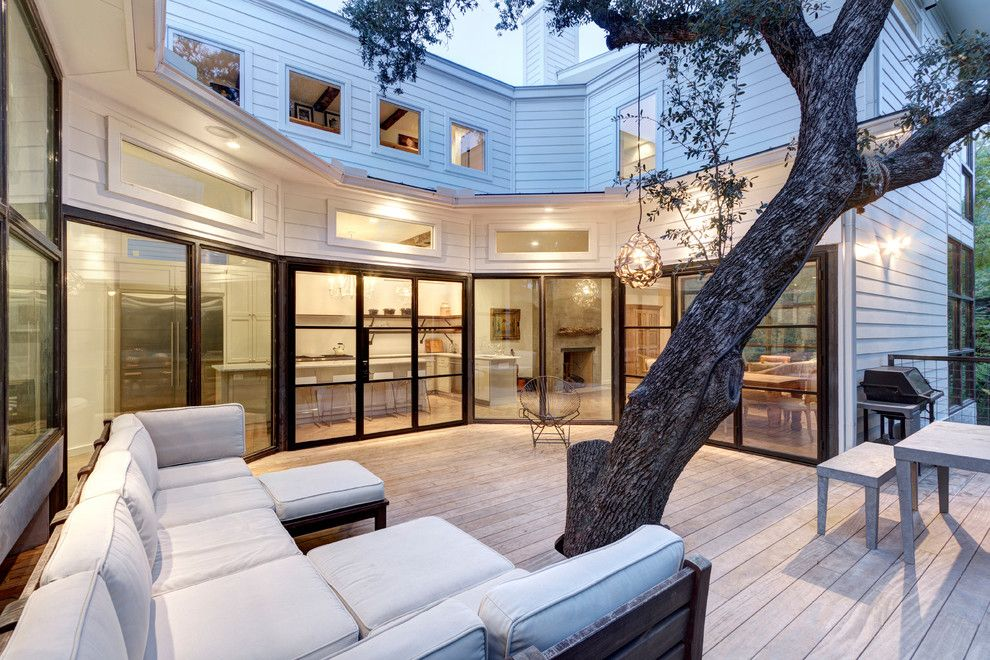 Gonzalez Furniture for a Transitional Deck with a Tree in Patio and Bouldin Creek Residence by Restructure Studio