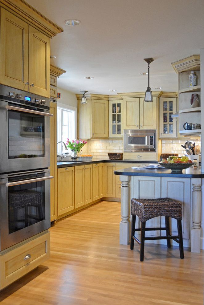 Gothic Cabinet for a Traditional Kitchen with a Double Oven and 1920s Tudor Bungalow Kitchen by Brian Dittmar Design, Inc.