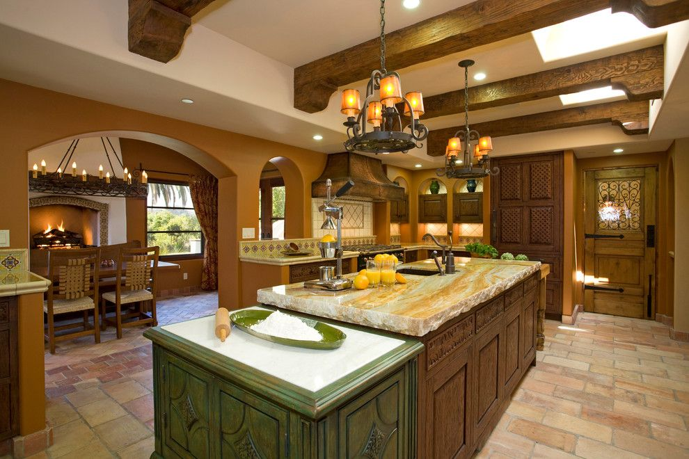 Granite Countertop Edges for a Mediterranean Kitchen with a Exposed Wood Beams and Haute Hacienda by Hamilton Gray Design, Inc.
