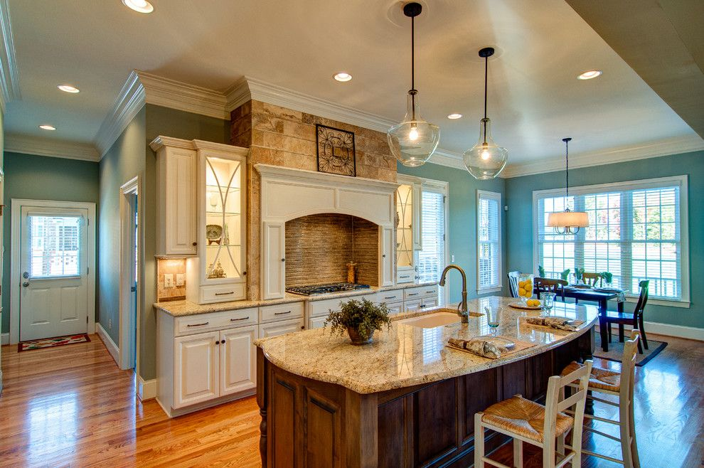 Granite State Glass for a Traditional Kitchen with a Colonial Cream Granite and Parade of Homes Sonoma Building Company by Bloomday Granite