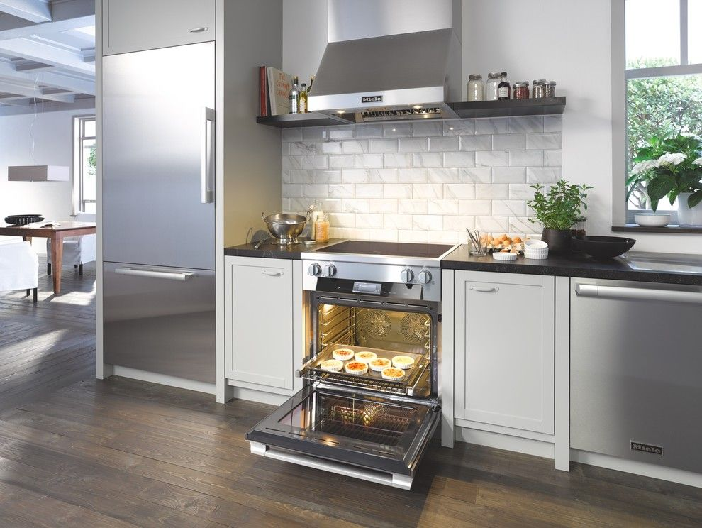 Greenfront Furniture for a Modern Kitchen with a White Subway Tile and Miele by Miele Appliance Inc