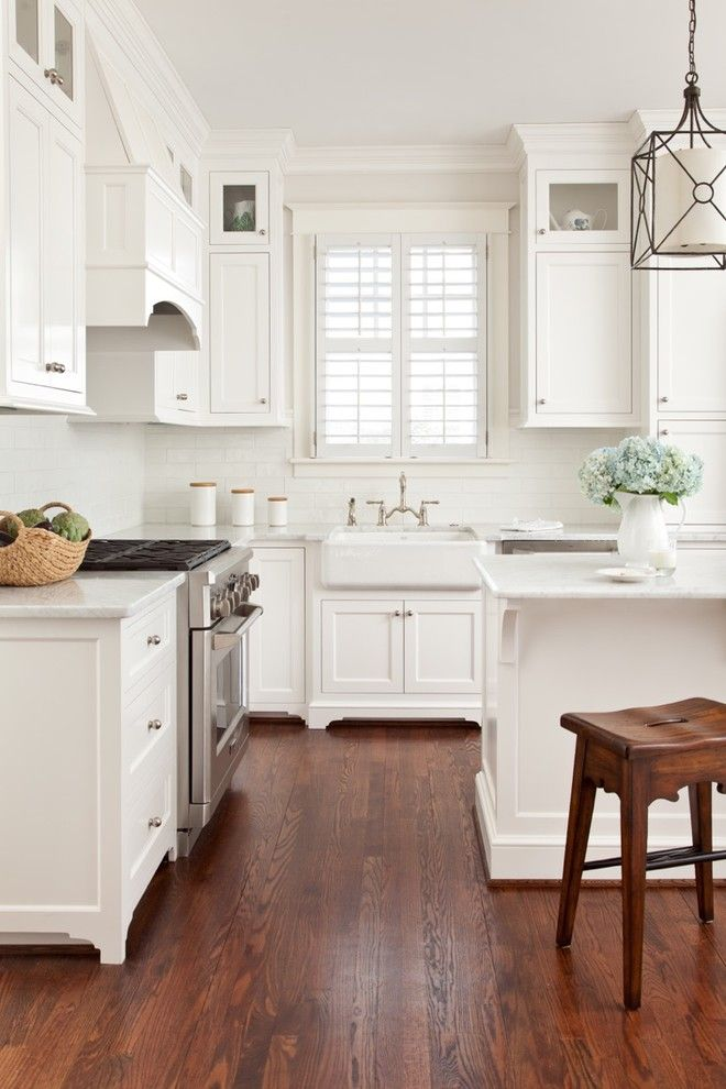 Greenfront Furniture for a Traditional Kitchen with a Farm Sink and Recent Kitchen Renovations by Carnes Home Builders