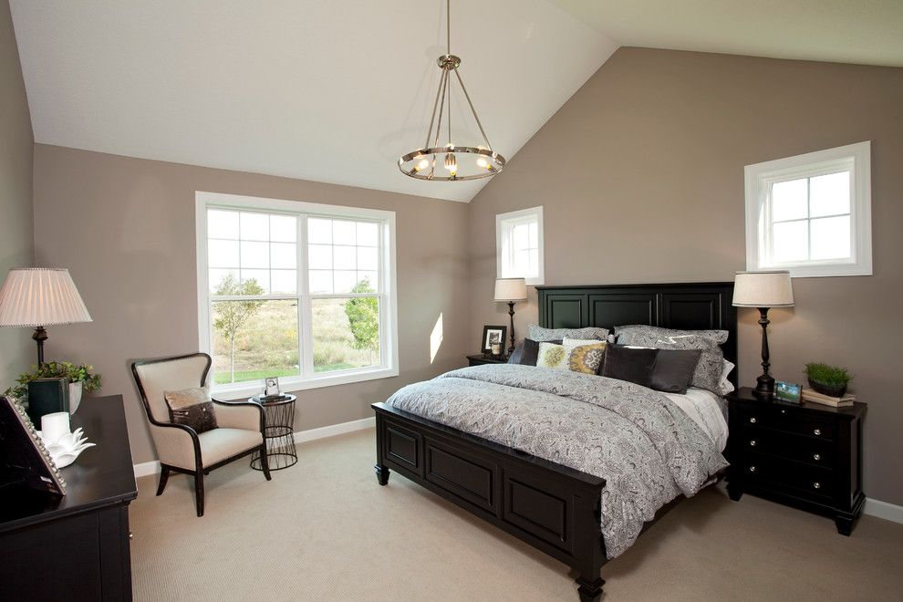 Greige Paint for a Traditional Bedroom with a Beige Carpet and the Arlington Ii by Homes by Tradition