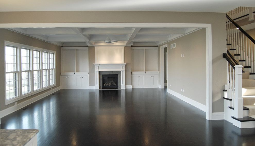 Greige Paint for a Traditional Family Room with a Coffered Ceilings and Custom Floor Plan Aps Family Room by King's Court Builders, Inc.
