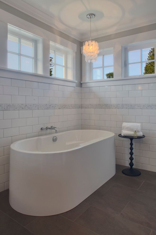 Grouting Tile for a Traditional Bathroom with a Bathtub and Qualicum Beach Residence by Richardson Homes Ltd