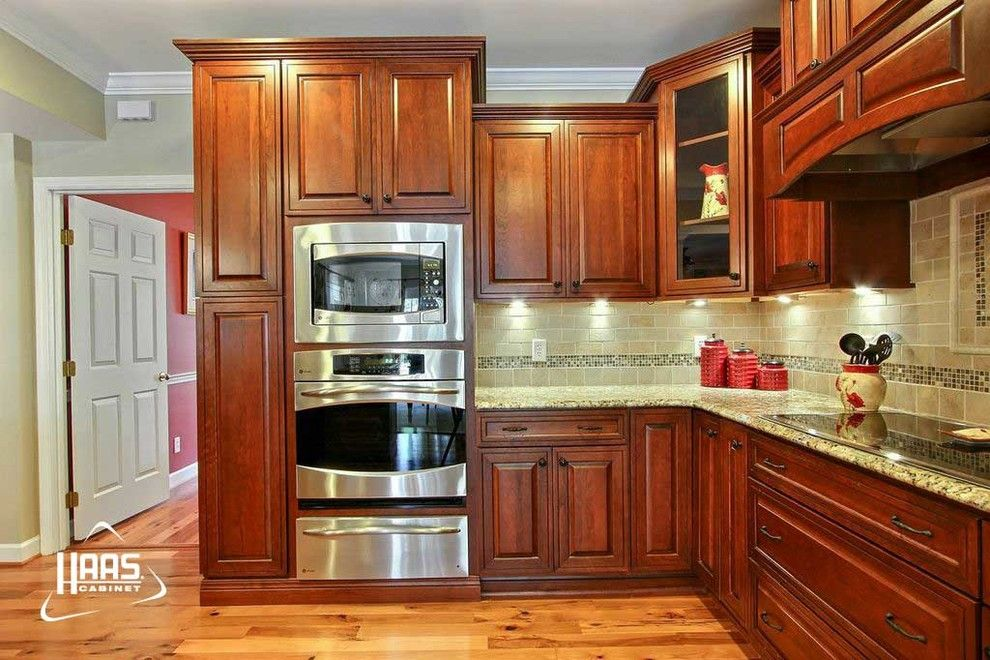 Haas Cabinets for a Craftsman Kitchen with a Red and Colonial Cherry | Haas Cabinet by Haas Cabinets