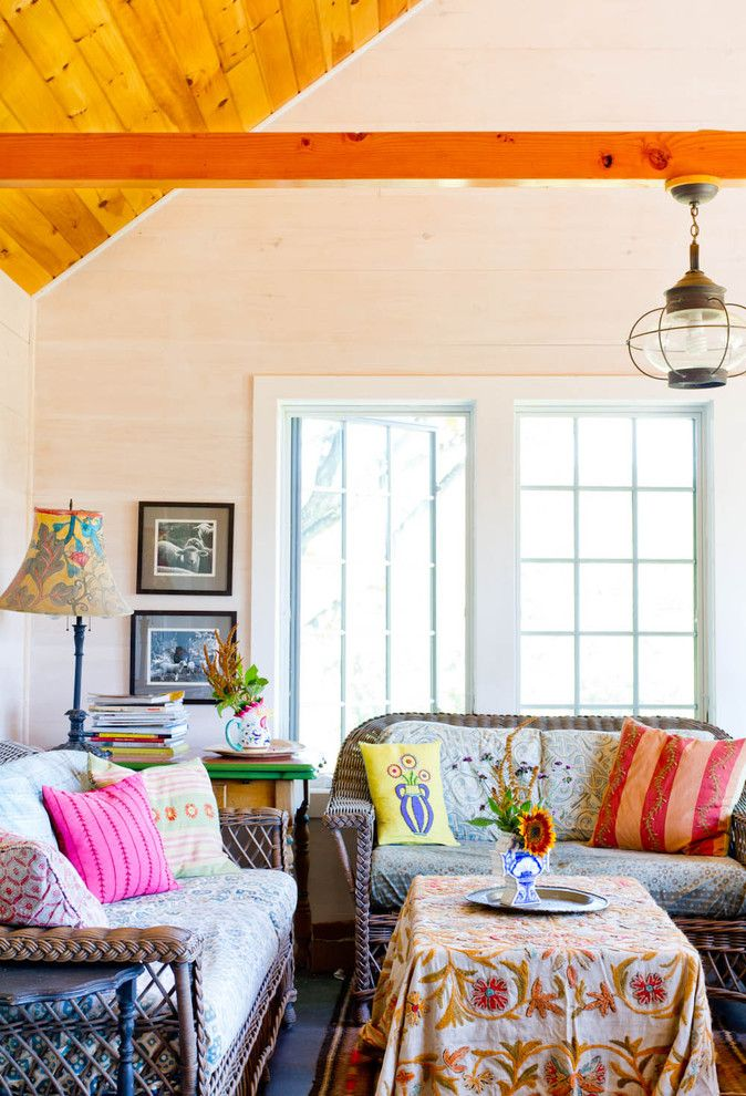 Hacienda Lighting for a Farmhouse Family Room with a Patterned Cushions and My Houzz: An Antique Cape Cod House Explodes with Color by Rikki Snyder