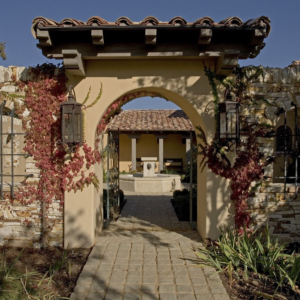 Hacienda Lighting for a Mediterranean Entry with a Sidewalk and Spanish Colonial Hacienda, Carmel, California by John Malick & Associates