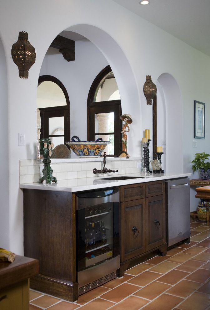 Hacienda Lighting for a Mediterranean Kitchen with a Wall Lighting and Hacienda Kitchen by Hann Builders